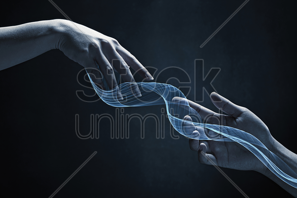human hands reaching out for each other stock photo