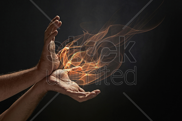 human hands with fire coming out of it stock photo