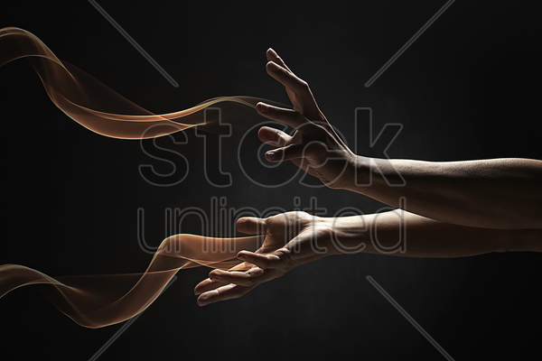 human hands with fire flowing out of it stock photo