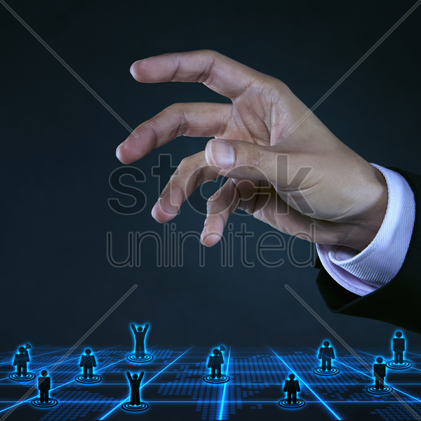 human palm above digital figurines stock photo
