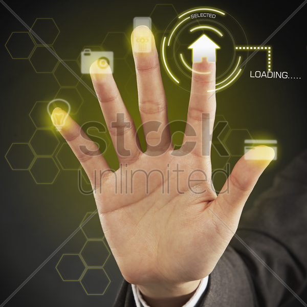 human palm placed against a touch screen stock photo