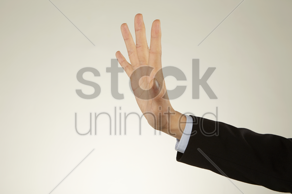 human palm reaching out stock photo
