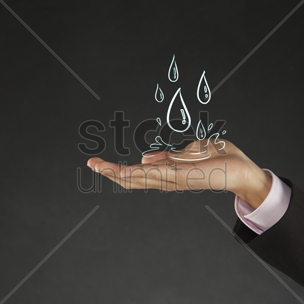 illustration of water drops falling on human palm stock photo