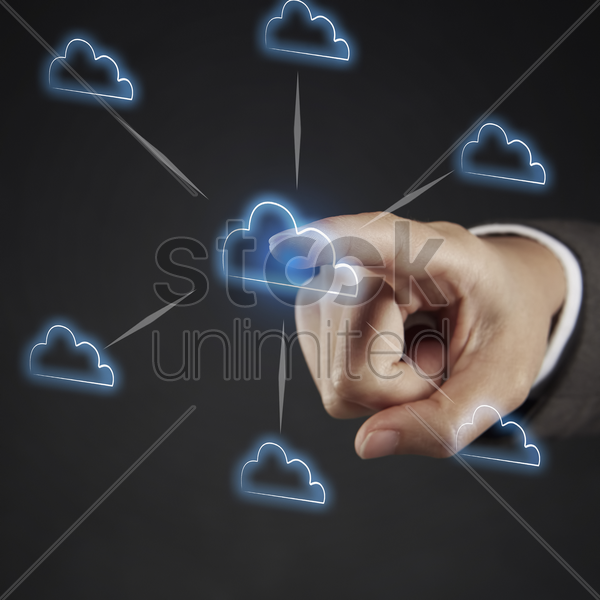 index finger pointing at a cloud shaped flow chart stock photo