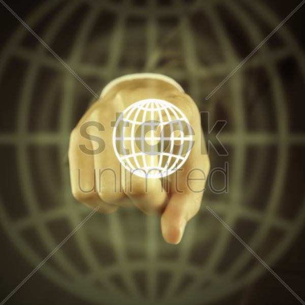 index finger pointing at a digital graphic globe stock photo