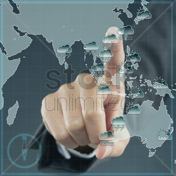 index finger pointing at a global map stock photo