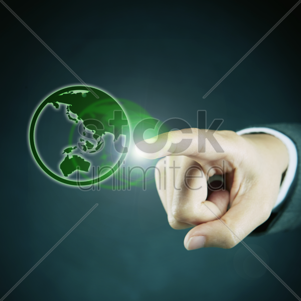index finger pointing at a globe stock photo