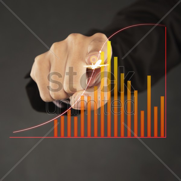 index finger pointing at a graph chart stock photo