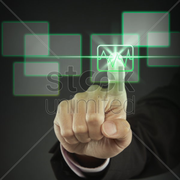 index finger pointing at a graph icon stock photo