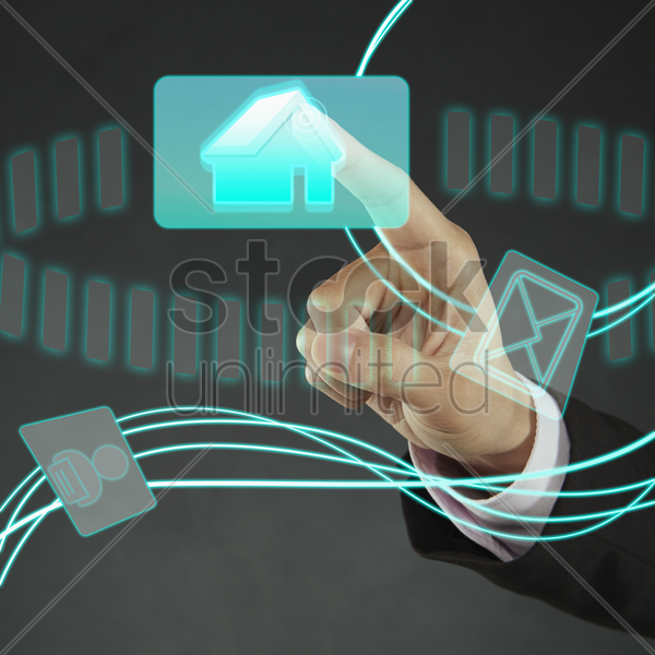 index finger pointing at a home icon stock photo