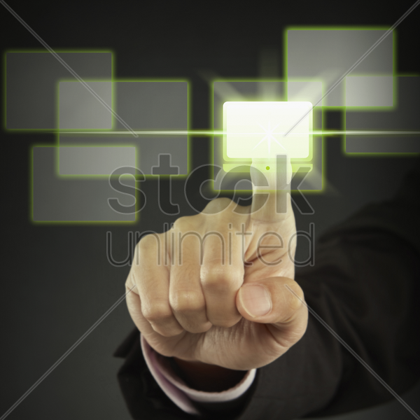 index finger pointing at a laptop icon stock photo