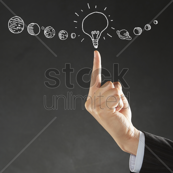 index finger pointing at a light bulb illustration stock photo