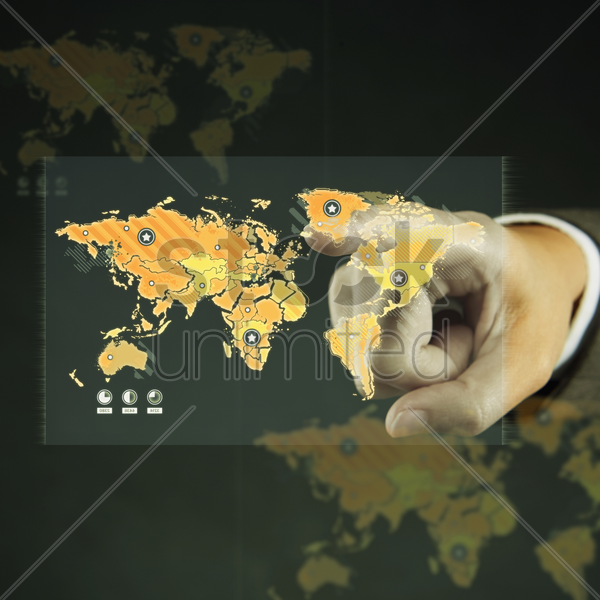 index finger pointing at a map stock photo