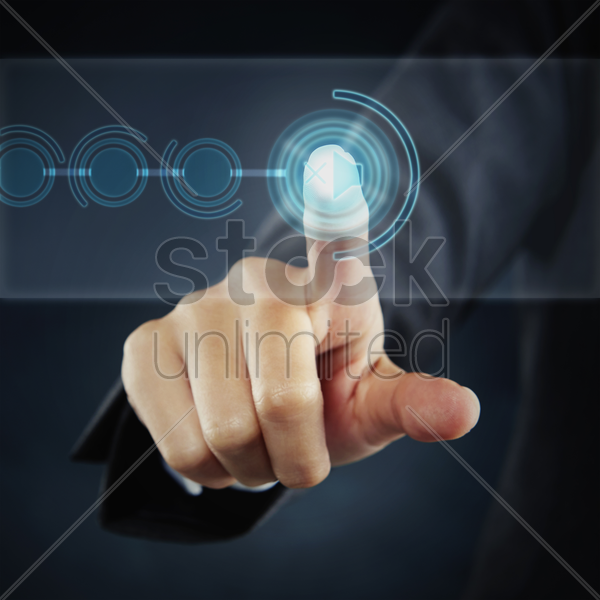 index finger pointing at a mute button stock photo