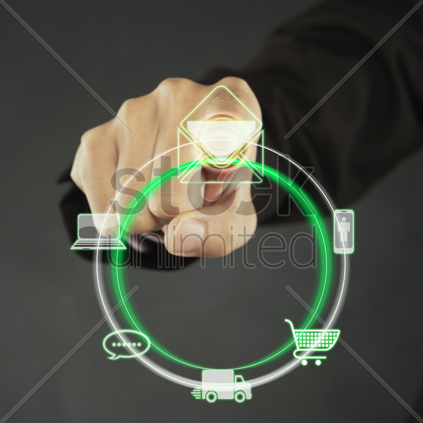 index finger pointing at an icon of a multipurpose touch screen menu stock photo
