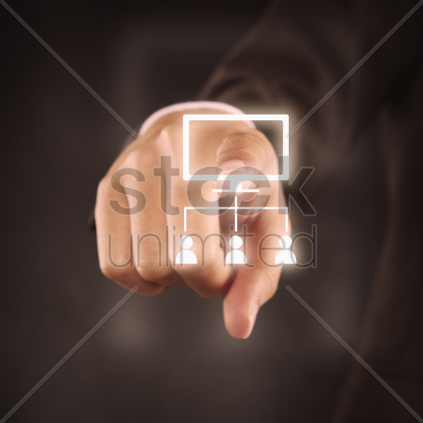 index finger pointing at an organizational chart stock photo