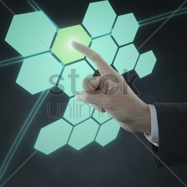 index finger pointing at blank digital honeycomb stock photo