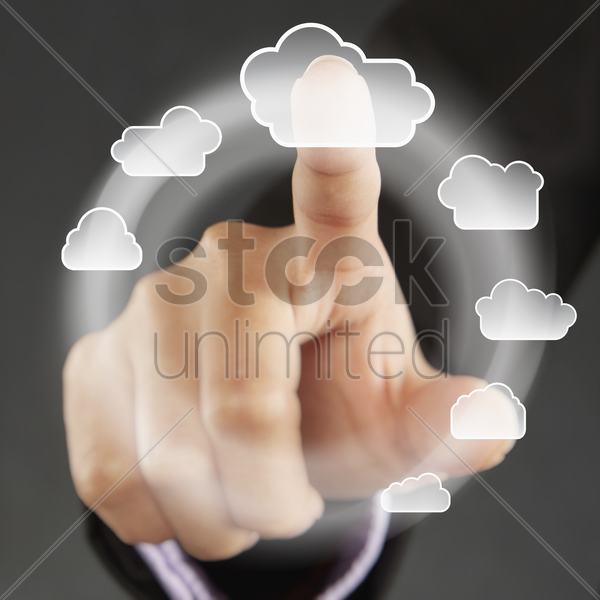index finger pointing at cloud symbols on a touch screen menu stock photo