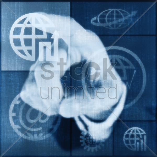 index finger pointing at digital graphic of globes stock photo