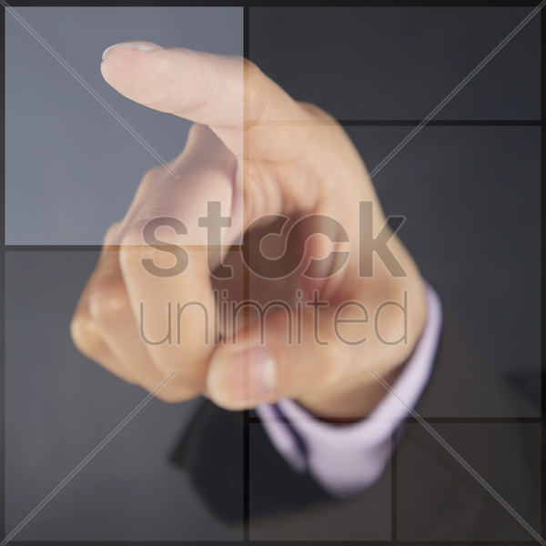 index finger pointing at digital graphic tiles stock photo