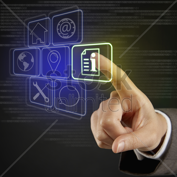 index finger pointing at digital tiles with different symbols stock photo