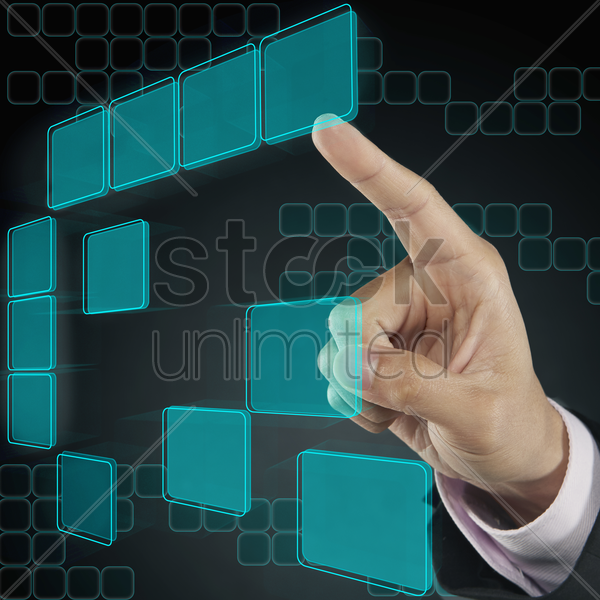 index finger pointing at digital tiles stock photo