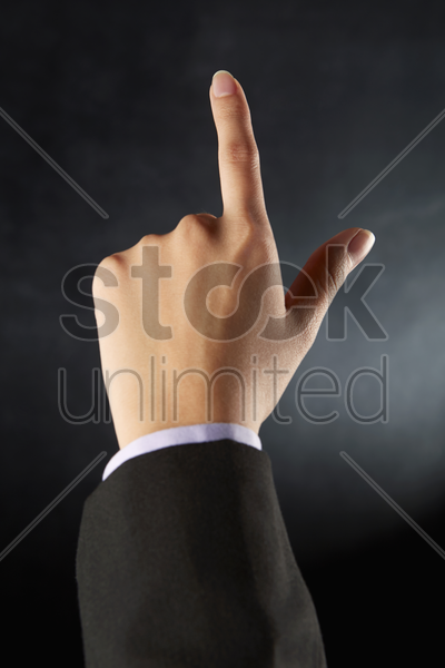 index finger pointing forward stock photo