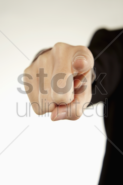 index finger pointing to one direction stock photo