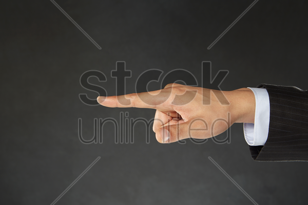 index finger pointing towards one direction stock photo