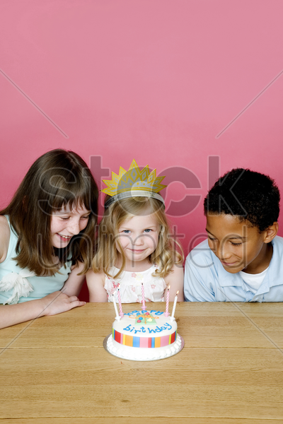 kids celebrating birthday stock photo