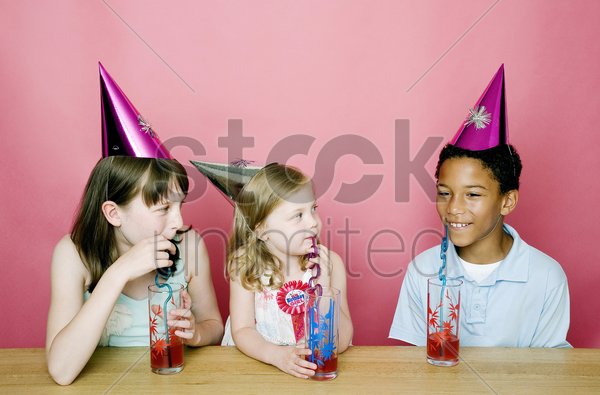 kids chatting while drinking stock photo