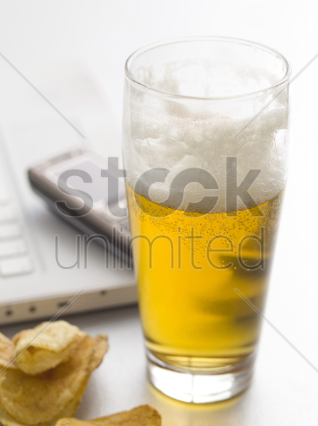 lager and crisps stock photo