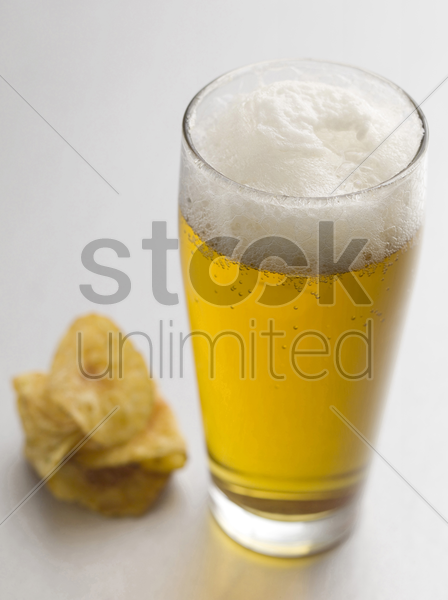 lager and potato chip stock photo