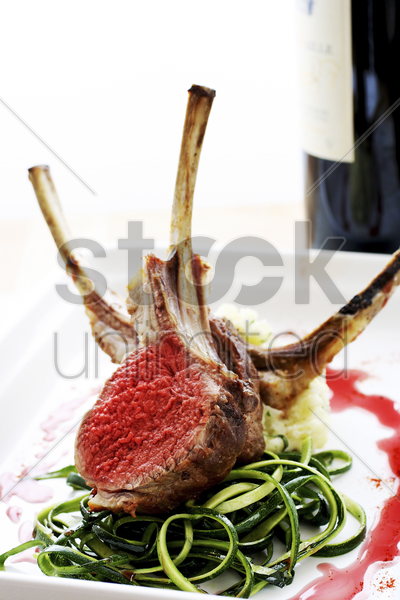 lamb chop on dinner plate stock photo