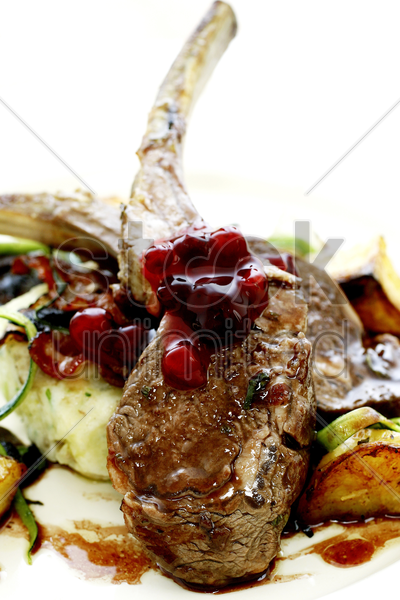 lamb chop with cranberries stock photo