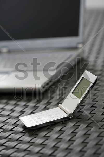 laptop and cell phone stock photo