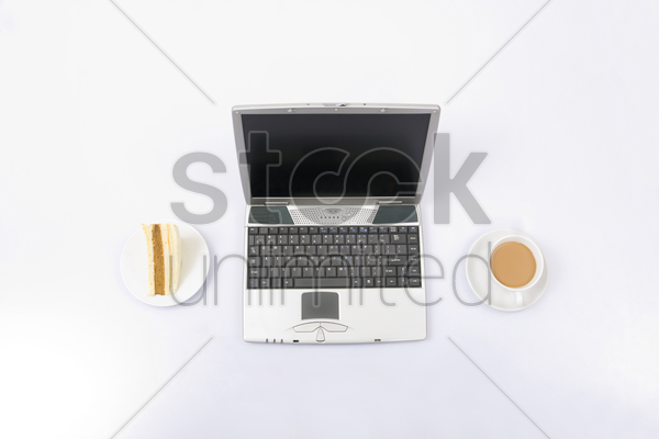 laptop with coffee and sandwich stock photo