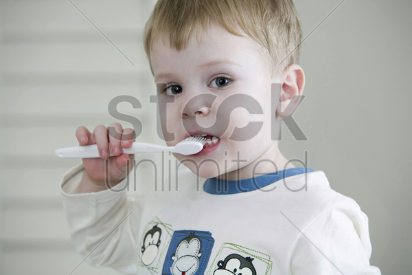 little boy brushing teeth stock photo