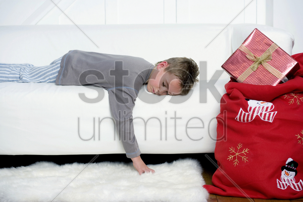 little boy sleeping on the sofa stock photo