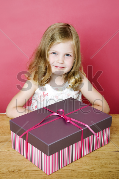 little girl taking photo with her present stock photo