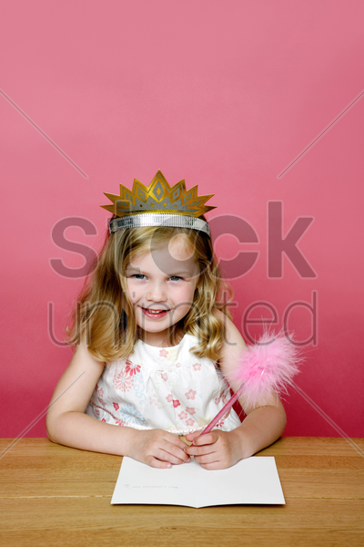 little girl writing a greeting card stock photo