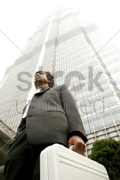low angle view of a businessman carrying a briefcase stock photo