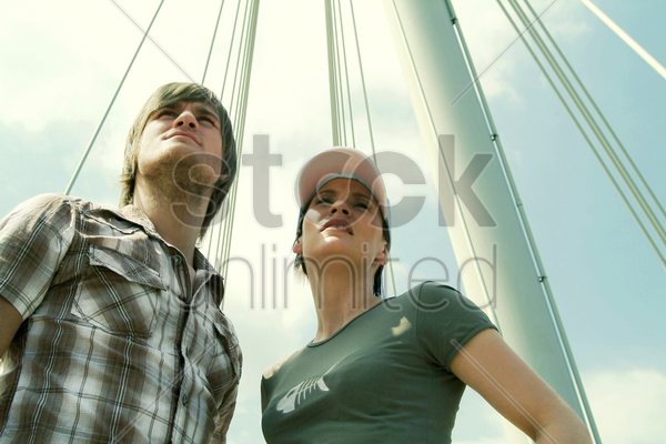 low angle view of a couple standing together stock photo