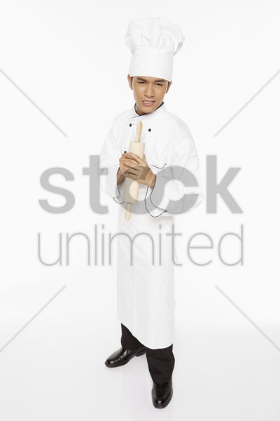 male chef showing an angry facial expression stock photo