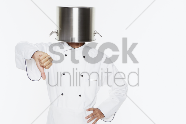 male chef showing hand gesture stock photo