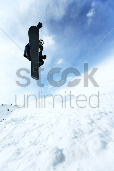 male snowboarder in air stock photo