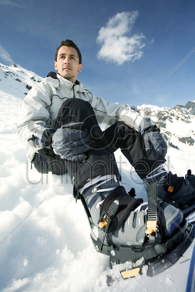 male snowboarder looking away stock photo
