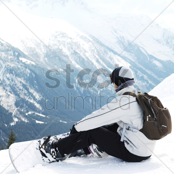 male snowboarder with backpack stock photo