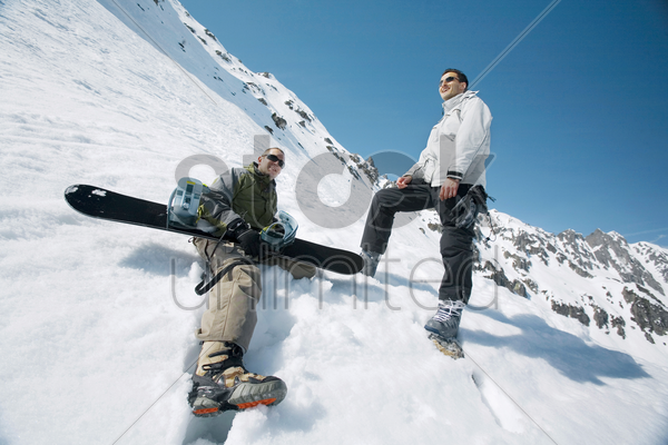 male snowboarders stock photo
