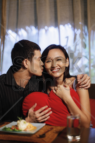 man about to kiss woman stock photo